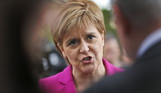 Scottish First Minster Nicola Sturgeon talks to journalists after meeting in London, in this Monday, May 23, 2016, file photo. Scotland's leader Nicola Sturgeon will seek authority to hold a new independence referendum in the next two years because Britain is dragging Scotland out of the European Union against its will, she said Monday March 13, 2017. (AP Photo/Frank Augstein, File)