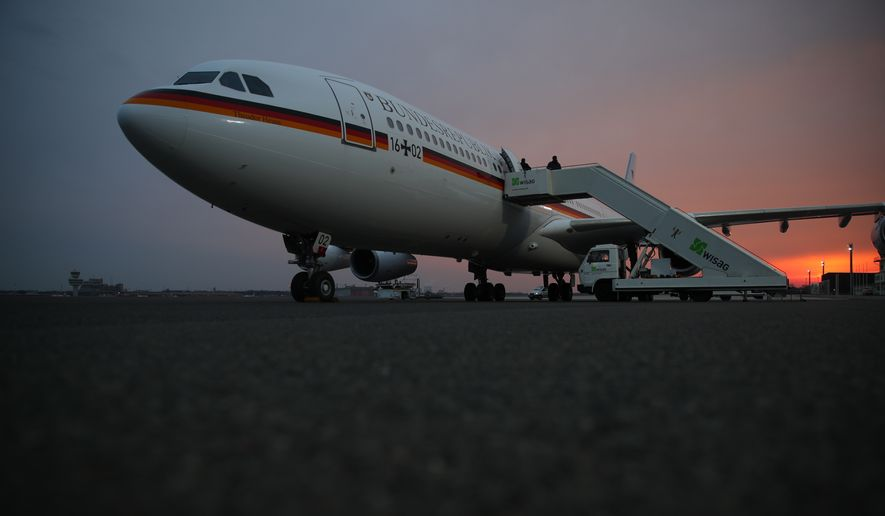 Der Airbus A340 stands at Berlin Tegel airport in Berlin. Monday March 13, 2017. and waits for German chancellor Angela Merkel and her delegation for their flight to the USA to meet with president Donald Trump.   (Michael Kappeler/dpa via AP)