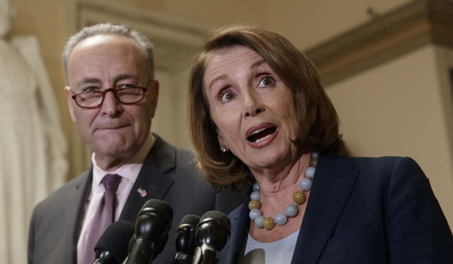 House Democratic Leader Nancy Pelosi of California, and Senate Democratic Leader Chuck Schumer of New York speak to reporters about the Congressional Budget Office projection that 14 million people would lose health coverage under the House Republican bill dismantling former President Barack Obama's health care law, on Capitol Hill in Washington, Monday, March, 13, 2017. (AP Photo/J. Scott Applewhite)