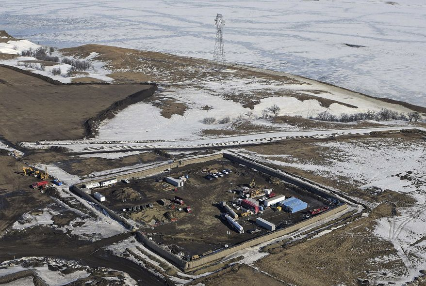 This Feb. 13, 2017, aerial file photo shows the site where the final phase of the Dakota Access Pipeline will take place with boring equipment routing the pipeline underground and across Lake Oahe to connect with the existing pipeline in Emmons County near Cannon Ball, N.D. (Tom Stromme/The Bismarck Tribune via AP, File)