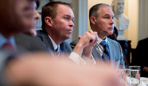 Budget Director Mick Mulvaney, left, and EPA Administrator Scott Pruitt, right, listen as President Donald Trump speaks during a meeting with members of his Cabinet in the Cabinet Room at the White House, Monday, March 13, 2017, in Washington. (AP Photo/Andrew Harnik)