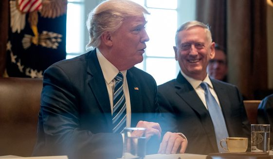 Defense Secretary Jim Mattis, right, smiles as President Donald Trump meets with members of his Cabinet in the Cabinet Room at the White House, Monday, March 13, 2017, in Washington. (AP Photo/Andrew Harnik)