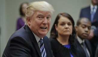 President Donald Trump speaks during a meeting on healthcare in the Roosevelt Room of the White House in Washington, Monday, March 13, 2017. Also at the meeting are holds Carrie Couey, center, from Colorado and Louis Brown, right, from Virginia. (AP Photo/Pablo Martinez Monsivais)