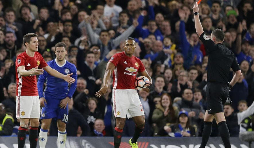 Manchester United's Ander Herrera, left, reacts as referee Michael Oliver shows him a red card and sends him off during the English FA Cup quarterfinal soccer match between Chelsea and Manchester United at Stamford Bridge stadium in London, Monday, March 13, 2017 (AP Photo/Alastair Grant)