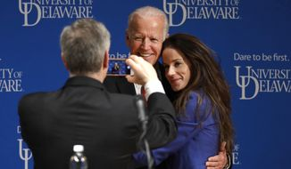 Former Vice President Joe Biden poses for a photograph with his daughter Ashley Biden following an event to formally launch the Biden Institute, a research and policy center focused on domestic issues at the University of Delaware, in Newark, Del., Monday, March 13, 2017. (AP Photo/Patrick Semansky)