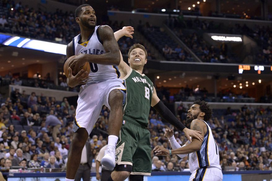 Memphis Grizzlies guard Troy Daniels, left, grabs a rebound ahead of Milwaukee Bucks guard Matthew Dellavedova (8) and Grizzlies guard Mike Conley, right, in the first half of an NBA basketball game Monday, March 13, 2017, in Memphis, Tenn. (AP Photo/Brandon Dill)