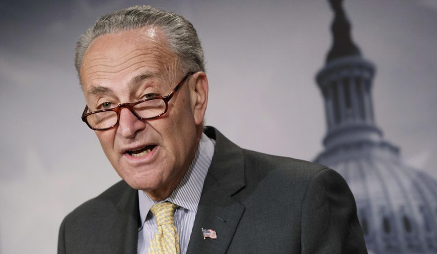 """Senate Minority Leader Charles E. Schumer, New York Democrat, has warned that any """"poison pill"""" policy riders would galvanize his members to defeat a funding package. (Associated Press/File)"""