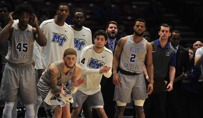 The Middle Tennessee bench comes off their seats with seconds left before victory over Marshall in the NCAA college basketball game during the championship game of the Conference USA tournament, Saturday, March 11, 2017, in Birmingham, Ala. (AP Photo/Eric Schultz)