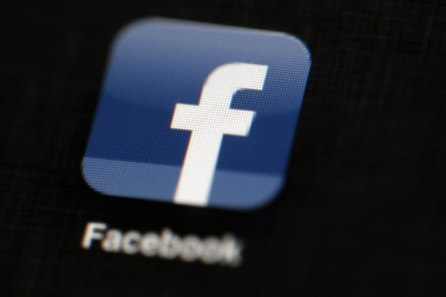 In this May 16, 2012, file photo, the Facebook logo is displayed on an iPad in Philadelphia. (AP Photo/Matt Rourke, File) **FILE**