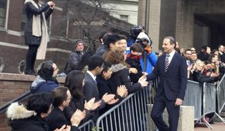 In this image made from a video, former U.S. Attorney for the Southern District of New York Preet Bharara, walks down a line of applauding well-wishers Monday, March 13, 2017, in front of the New York office where he worked until he was fired by President Donald Trump's administration over the weekend after refusing to resign. (AP Photo/Larry Neumeister)