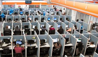 Workers man a call center in the southwestern U.S. (AP file photo)