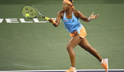 Naomi Osaka, of Japan, returns a shot to Madison Keys at the BNP Paribas Open tennis tournament, Monday, March 13, 2017, in Indian Wells, Calif. (AP Photo/Mark J. Terrill)