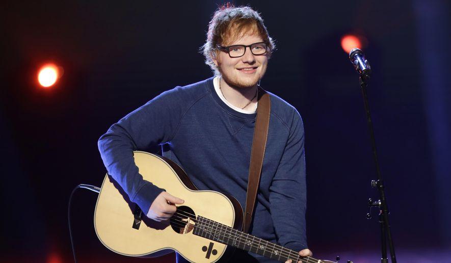 """British singer Ed Sheeran performs during the Italian State RAI TV program """"Che Tempo che Fa"""", in Milan, Italy, Sunday, March 12, 2017. (AP Photo/Antonio Calanni)"""