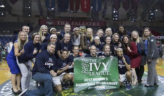 Pennsylvania poses with the Ivy League tournament trophy following an NCAA college basketball championship game against Princeton, Sunday, March 12, 2017, in Philadelphia. Pennsylvania won 57-48. (AP Photo/Chris Szagola)