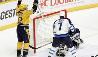 Nashville Predators center Mike Fisher (12) celebrates after teammate James Neal, not shown, scored against the Winnipeg Jets during overtime in an NHL hockey game, Monday, March 13, 2017, in Nashville, Tenn. The Predators won 5-4. Defending for the Jets is Ben Chiarot (7). (AP Photo/Mark Humphrey)