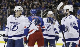Tampa Bay Lightning's Brayden Point, left, celebrates with teammate Nikita Kucherov (86) after scoring a goal during the first period of an NHL hockey game against the New York Rangers, Monday, March 13, 2017, in New York. (AP Photo/Frank Franklin II)