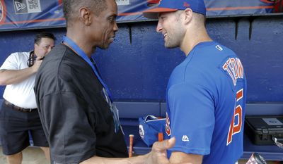 New York Mets' Tim Tebow, right, talks with former Mets pitcher Dwight Gooden before a spring training baseball game against the Miami Marlins, Monday, March 13, 2017, in Port St. Lucie, Fla. (AP Photo/John Bazemore)