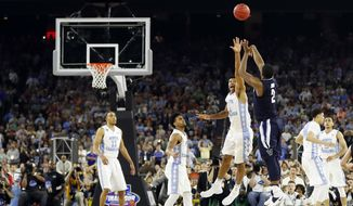 FILE - In this April 4, 2016, file photo, Villanova's Kris Jenkins makes the game-winning three-point shot during the second half of the NCAA Final Four tournament college basketball championship game against North Carolina, in Houston. North Carolina players are, from left: Brice Johnson (11), Joel Berry, Isiah Hicks (4), Justin Jackson (44) and Marcus Paige (5).  Nearly a year after Jenkins' shot, the Wildcats and Tar Heels are both No. 1 seeds in the NCAA Tournament. (AP Photo/David J. Phillip, File)