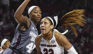 FILE - In this Sunday, March 5, 2017, file photo, South Carolina forward A'ja Wilson (22) drives against Mississippi State center Chinwe Okorie (45) in the first half of an NCAA college basketball game during the Southeastern Conference tournament in Greenville, S.C. South Carolina is traveling West for the NCAA Tournament again. The Gamecocks earned their fourth straight No. 1 seed, heading up the Stockton, California, regional in the brackets announced Monday, March 13. (AP Photo/Rainier Ehrhardt, File)