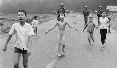 "FILE - In this June 8, 1972 file photo taken by Huynh Cong ""Nick' Ut, South Vietnamese forces follow terrified children, including 9-year-old Kim Phuc, center, as they run down Route 1 near Trang Bang after an aerial napalm attack on suspected Viet Cong hiding places. After making the photo, he set aside his camera, gave the badly burned girl water, poured more on her wounds, then loaded her and others into his AP van to take them to a hospital. When doctors refused to admit her, saying she was too badly burned to be saved, he angrily flashed his press pass. The next day, he told them, pictures of her would be displayed all over the world, along with an explanation of how the hospital refused to help. (AP Photo/Nick Ut, File)"