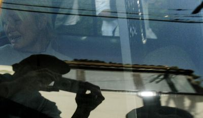 """FILE - In this Friday, June 8, 2007 file photo, Paris Hilton is transported in a police car from her home to court by the Los Angeles County Sheriff's Department in Los Angeles. As she was taken to jail for driving violations, this photo was made on the 35th anniversary of the day Ut made the """"Napalm Girl"""" picture in Vietnam. (AP Photo/Nick Ut)"""