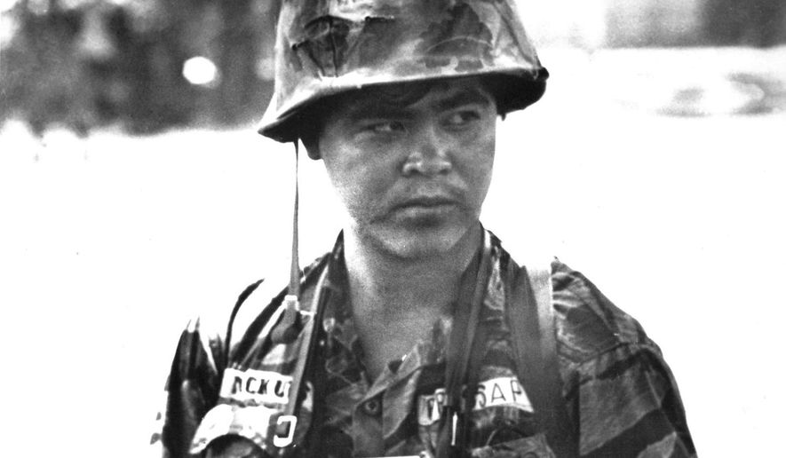 FILE - This undated file photo shows Associated Press photographer Nick Ut in Vietnam. Ut will be retiring from the AP in March 2017 after 51 years of taking photographs from the front lines of the Vietnam War to the red carpets of Hollywood. (AP Photo)
