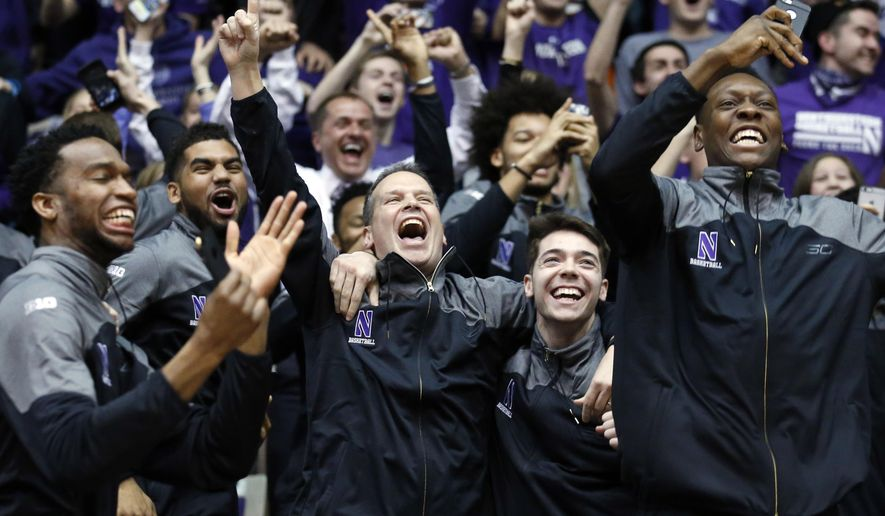 Northwestern coach Chris Collins, center, and players react as the watch the broadcast of the NCAA men's basketball tournament selection show, Sunday, March 12, 2017, in Evanston, Ill. Northwestern will play Vanderbilt in the first round, in Northwestern's first appearance in the tournament. (AP Photo/Nam Y. Huh)