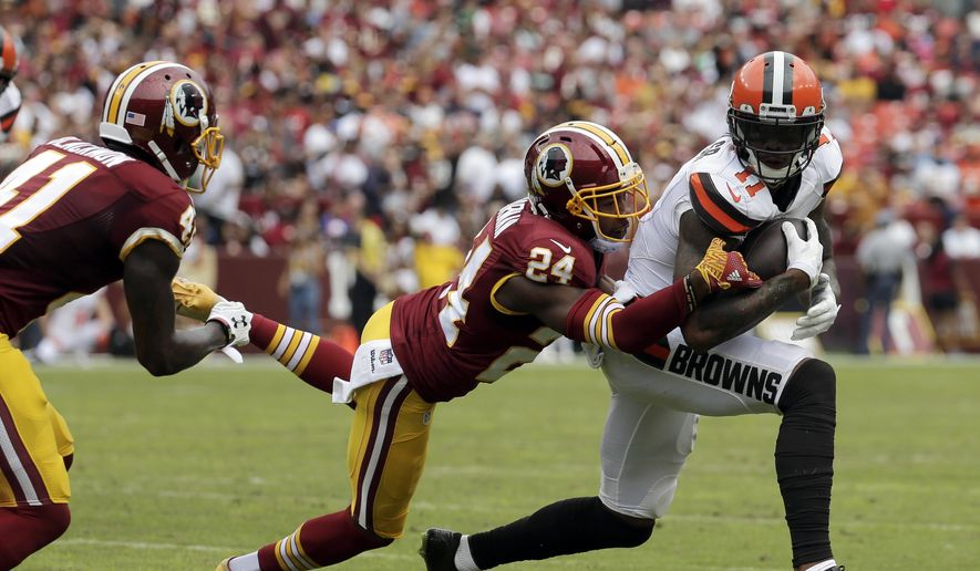 FILE- In this Oct. 2, 2016, file photo, Cleveland Browns wide receiver Terrelle Pryor (11) is tackled by Washington Redskins cornerback Josh Norman (24) during the first half of an NFL football game in Landover, Md. The Redskins signed quarterback-turned-receiver Terrelle Pryor to help fill the void left by the departures of DeSean Jackson and Pierre Garcon. After a battle with Redskins cornerback Josh Norman last season, Pryor gets to show what he can do. (AP Photo/Chuck Burton, File)
