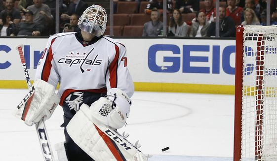 FILE- In this Sunday, March 12, 2017, file photo Washington Capitals goalie Braden Holtby laments as the puck pounces out of the net, after a goal by Anaheim Ducks center Rickard Rakell during the second period of an NHL hockey game in Anaheim, Calif. The Capitals have lost four straight games. The overall NHL leaders are hoping this late-season adversity finally gives them the toughness necessary for playoff success. (AP Photo/Alex Gallardo, File)
