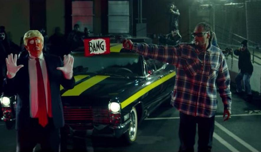 """Snoop Dogg shoots a toy gun at a clown dressed as President Trump in a new music video for """"Lavender."""" (Jesse Wellens)"""