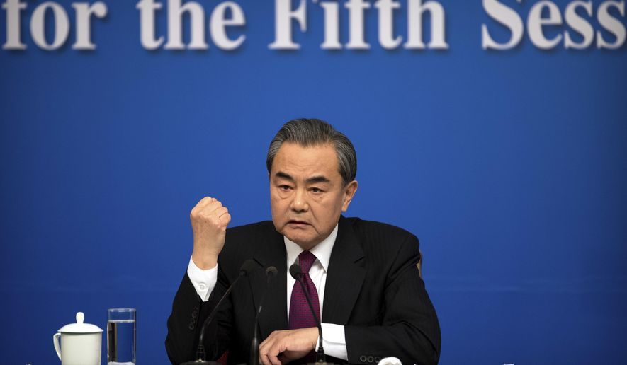 In this March 8, 2017 photo, Chinese Foreign Minister Wang Yi gestures while speaking during a press conference held on the sidelines of the National People's Congress at the media center in Beijing. Talks between China and the 10 members of the Association of Southeast Asian Nations has produced a draft version of a long-awaited code of conduct aiming to reduce the potential for conflicts in the South China Sea, Wang told reporters at the press conference. (AP Photo/Mark Schiefelbein)