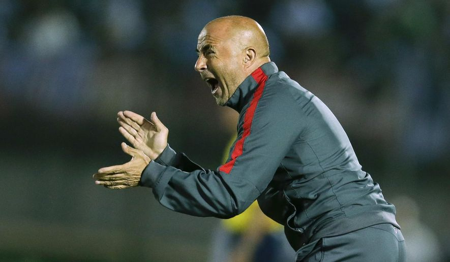 FILE - In this Nov. 17, 2015, file photo, Chilean soccer team coach Jorge Sampaoli gestures to his players during a FIFA World Cup qualifying soccer match between Uruguay and Chile in Montevideo. Sampaoli is now coach for Spain's Sevilla and the team's recent performances have raised concerns just ahead of the team's decisive Champions League match against Leicester on Tuesday March 14, 2017. (AP Photo/Victor R. Caivano, File)