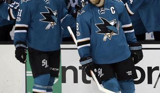 San Jose Sharks' Joe Pavelski (8) turns from the bench after being congratulated after scoring his second goal against the Dallas Stars during the second period of an NHL hockey game Sunday, March 12, 2017, in San Jose, Calif. (AP Photo/Ben Margot)