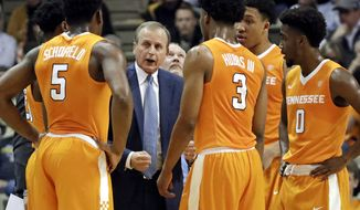 FILE - In this Jan. 14, 2017 file photo, Tennessee head coach Rick Barnes talks to his players during a timeout in the first half of an NCAA college basketball game against Vanderbilt in Nashville, Tenn. After relying heavily on freshmen during a 16-16 season that didn't result in an NCAA Tournament or NIT invitation, Tennessee understands a more experienced roster next season will bring higher expectations. The first step is to post a winning season, something the Volunteers haven't done since their 2014 NCAA regional semifinal appearance. (AP Photo/Mark Humphrey, File)