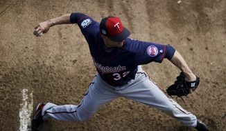 """FILE- In this Feb. 16, 2017, file photo, Minnesota Twins pitcher Ryan Vogelsong winds up to throw in the bullpen during a baseball spring training workout in Fort Myers, Fla. The right-hander started for the Twins on Sunday, March 12, against the Pittsburgh Pirates in Bradenton, Fla. """"I still think I can get big league guys out consistently and help a team win, so that's why I'm here,"""" Vogelsong said. (AP Photo/David Goldman, File)"""