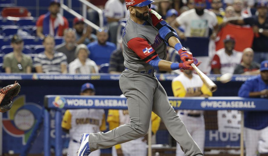 Dominican Republic's Jose Bautista hits an RBI-single to score Jean Segura during the first inning in a first-round game of the World Baseball Classic against Colombia, Sunday, March 12, 2017, in Miami. (AP Photo/Lynne Sladky)
