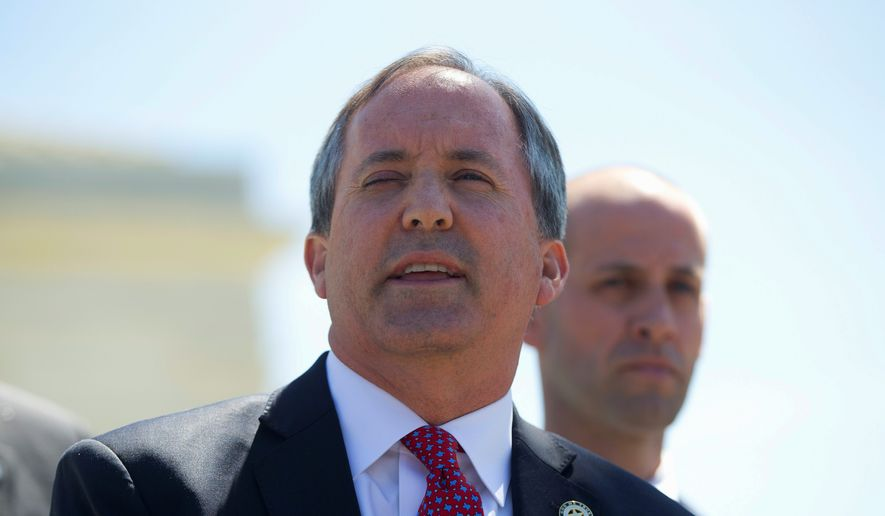 Texas Attorney General Ken Paxton, joined by nine other state attorneys general and the governor of Idaho, says in a letter that the 2012 amnesty created by President Obama and continued by President Trump is illegal. (Associated Press/File)