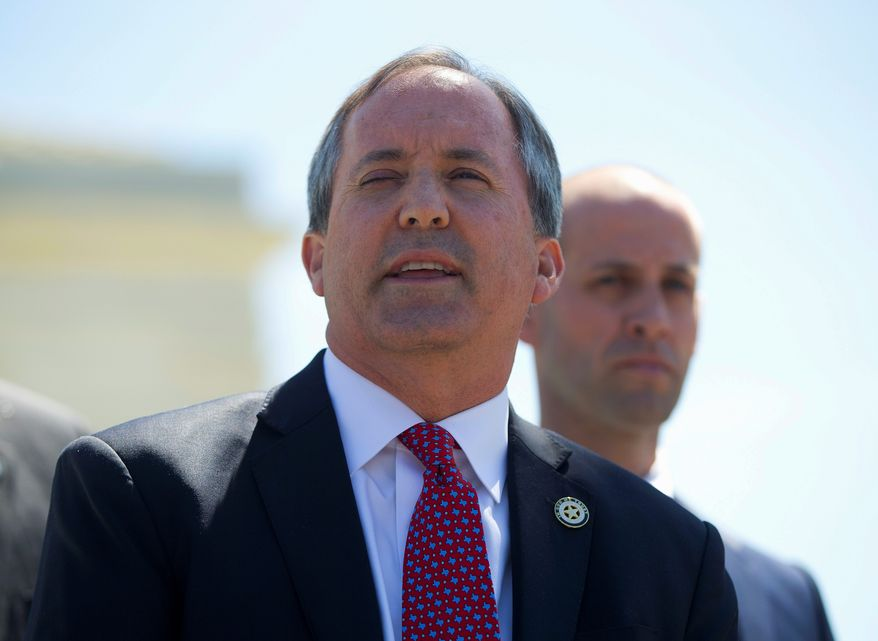 Texas Attorney General Ken Paxton, joined by nine other state attorneys general and the governor of Idaho, says in a letter that the 2012 amnesty created by President Obama and continued by President Trump is illegal. (Associated Press/File) **FILE**