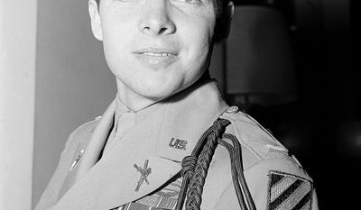 Lt. Audie Murphy (20 June 1925  28 May 1971) was one of the most decorated American combat soldiers of World War II, receiving every military combat award for valor available from the U.S. Army, as well as French and Belgian awards for heroism. Murphy received the Medal of Honor for valor demonstrated at the age of 19 for single-handedly holding off an entire company of German soldiers for an hour at the Colmar Pocket in France in January 1945, then leading a successful counterattack while wounded and out of ammunition. After the attack on Pearl Harbor, Murphy's older sister helped him to falsify documentation about his birthdate to meet the minimum-age requirement for enlisting in the military. Turned down by the Navy and the Marine Corps, he enlisted in the Army. He first saw action in the Allied invasion of Sicily and the Battle of Anzio, and in 1944 participated in the liberation of Rome and invasion of southern France. Murphy fought at Montélimar, and led his men on a successful assault at the L'Omet quarry near Cleurie in northeastern France in October. After the war, Murphy enjoyed a 21-year acting career. He played himself in the 1955 autobiographical film To Hell and Back, based on his 1949 memoirs of the same name, but most of his roles were in westerns. He made guest appearances on celebrity television shows and starred in the series Whispering Smith. Murphy died in a plane crash in Virginia in 1971 shortly before his 46th birthday, and was interred with full military honors at Arlington National Cemetery. (AP Photo/ Anthony Camerano)