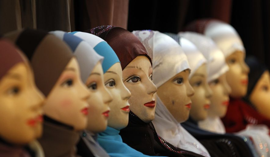 Mannequins with headscarves are on display at an exhibition hall for the Muslim World Fair in Le Bourget, outside Paris, Dec.17, 2011. Private businesses in Europe can forbid Muslim women in their employ from wearing headscarves if the ban is part of a policy of neutrality within the company and not a sign of prejudice against a particular religion, the European Court of Justice said Tuesday March 14, 2017. (AP Photo/Christophe Ena) ** FILE **