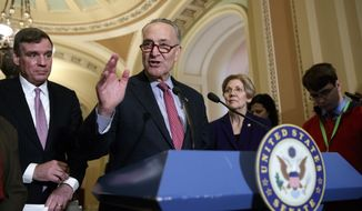 Senate Minority Leader Chuck Schumer, D-N.Y., joined by Sen. Mark Warner, D-Va., left, and Sen. Elizabeth Warren, D-Mass., right, speaks at the Capitol in Washington, Tuesday, March, 14, 2017. The White House and Republican leaders in Congress are scrambling to shore up support for their health care bill after findings from the Congressional Budget Office estimated that 14 million people would lose insurance coverage in the first year alone under the GOP replacement for Obamacare. (AP Photo/J. Scott Applewhite)
