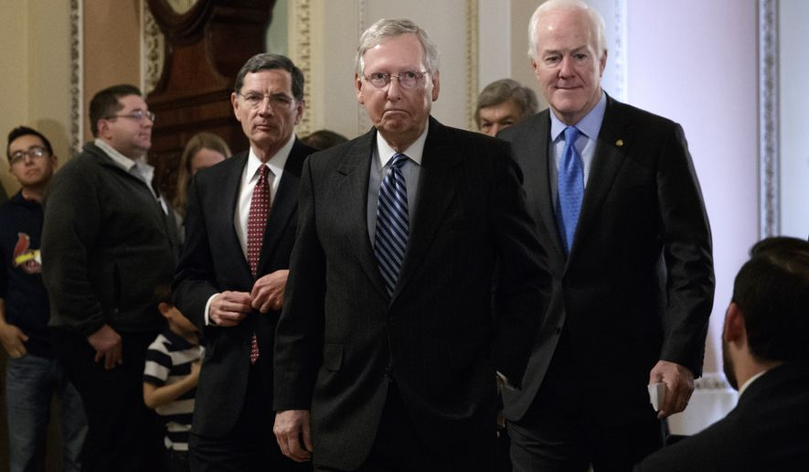 Senate Majority Leader Mitch McConnell, R-Ky., flanked by Sen. John Barrasso, R-Wyo., left, and Majority Whip John Cornyn, R-Texas, arrives to speak with reporters at the Capitol in Washington, Tuesday, March, 14, 2017. The White House and Republican leaders in Congress are scrambling to shore up support for their health care bill after findings from the Congressional Budget Office estimated that 14 million people would lose insurance coverage in the first year alone under the GOP replacement for Obamacare. (AP Photo/J. Scott Applewhite)