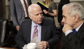 "Senate Armed Services Committee Chairman Sen. John McCain, R-Ariz., left, confers with the committee's ranking member, Sen. Jack Reed, D-R.I., on Capitol Hill in Washington, Tuesday, March, 14, 2017, prior to the start of the committee's hearing on the investigation of nude photographs of female Marines and other women that were shared on the Facebook page ""Marines United.""  (AP Photo/J. Scott Applewhite)"