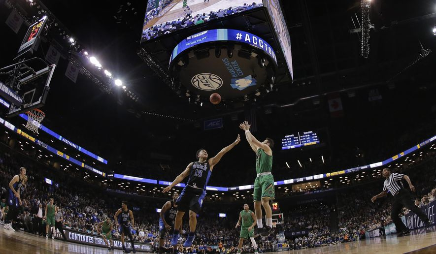 Notre Dame guard Matt Farrell (5) puts up a shot against Duke guard Frank Jackson (15) in the second half of an NCAA college basketball game during the championship game of the Atlantic Coast Conference tournament, Saturday, March 11, 2017, in New York. Duke won 75-69. (AP Photo/Julie Jacobson)