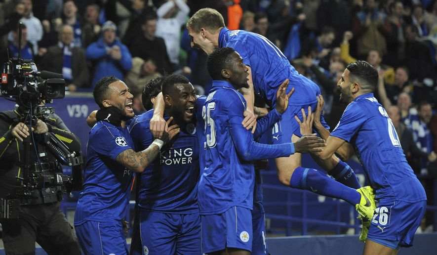 Leicester's Wes Morgan, second left, celebrates with team mates after he scores a goal during the Champions League round of 16 second leg soccer match between Leicester City and Sevilla at the King Power Stadium in Leicester, England, Tuesday, March 14, 2017. (AP Photo/Rui Vieira)