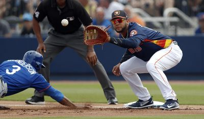 Houston Astros first baseman Yuli Gurriel (10) handles the late throw as New York Mets' Curtis Granderson dives back to first base during a spring training baseball game against the New York Mets Tuesday, March 14, 2017, in West Palm Beach, Fla. (AP Photo/John Bazemore)