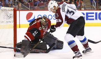 Arizona Coyotes goalie Mike Smith (41) makes a save on a shot by Colorado Avalanche center Carl Soderberg (34) during the first period of an NHL hockey game, Monday, March 13, 2017, in Glendale, Ariz. (AP Photo/Ross D. Franklin)