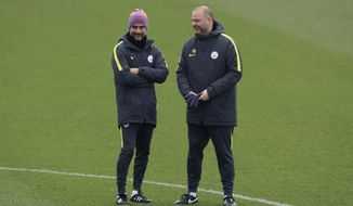 Manchester City manager Pep Guardiola, left and head of coaching Rodolfo Borrell talk, during the training session at the City Football Academy, in Manchester, England, Tuesday March 14, 2017. Manchester City will play Monaco in a second leg Champions League Round of 16 soccer match on Wednesday. (Peter Byrne/ PA via AP)