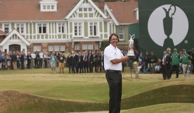 FILE - This is a Sunday July 21, 2013 file photo of Phil Mickelson of the United States holds up the Claret Jug trophy in front of the clubhouse after winning the British Open Golf Championship at Muirfield, Scotland. Muirfield voted Tuesday March 14, 2017 to admit female members for the first time in its 273-year history, paving the way for the Scottish golf club to again host the British Open. (AP Photo/Peter Morrison, File)