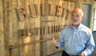 In this Thursday, March 9, 2017, photo, Tom Bulleit, founder of the Bulleit Distilling Co., talks about the brand's future at its new distillery outside Shelbyville, Ky. Bulleit's parent company, spirits giant Diageo, sees the $115 million distillery as a catalyst for more momentum for the fast-growing brand. (AP Photo/Bruce Schreiner)